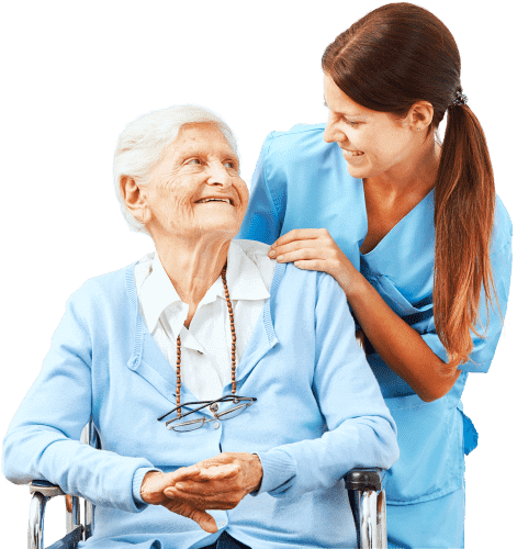 elderly woman on a wheelchair and a woman smiling at each other