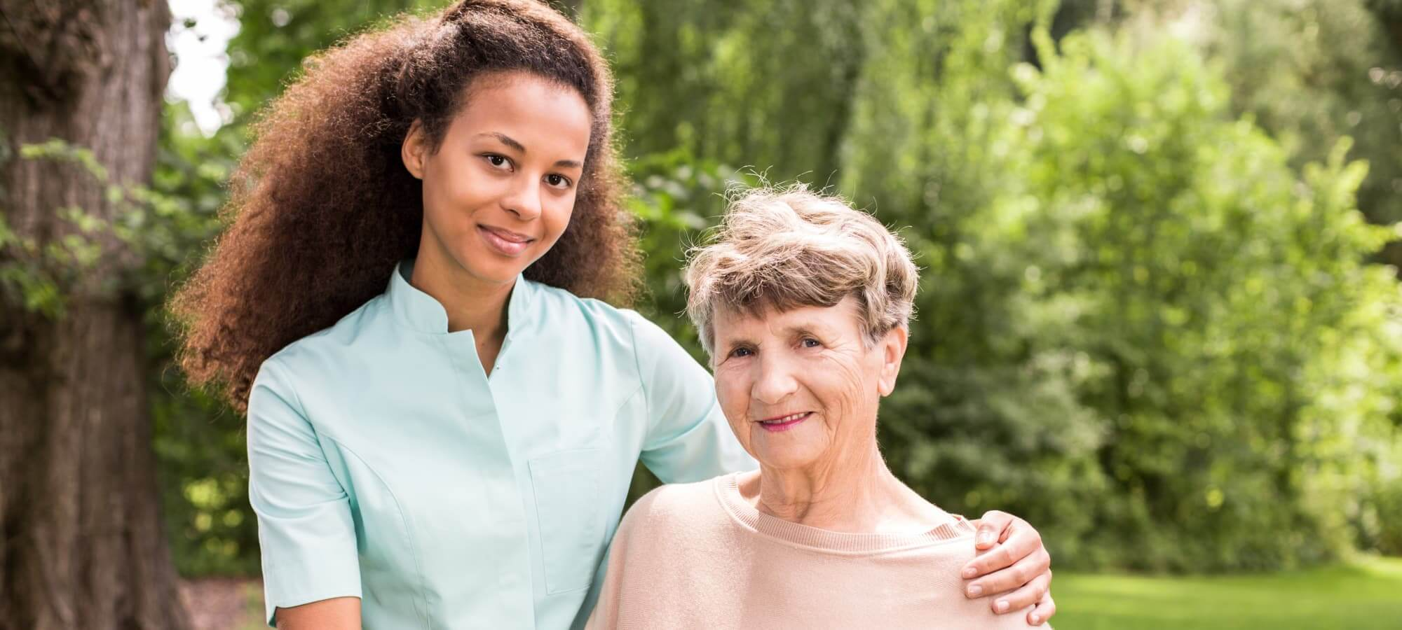 caregiver with her elderly patient